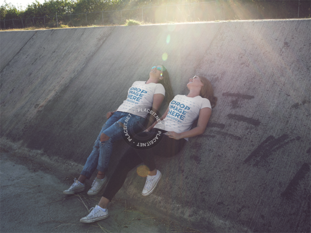 Two Girls Wearing Same Tshirts While Relaxing in an Industrial Area Mockup a13338