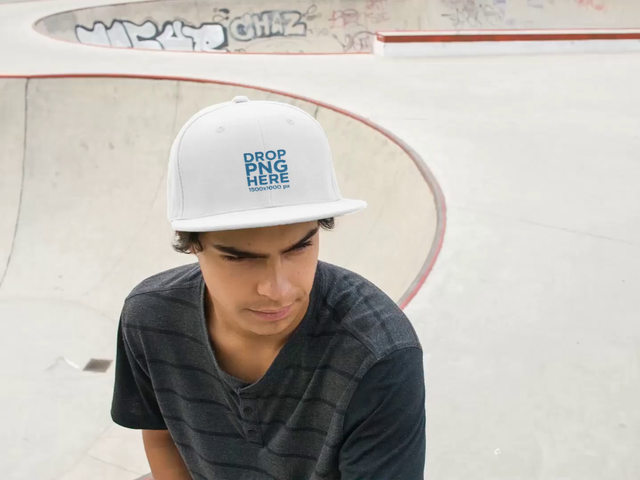 Young Biker Dude Wearing a Snapback Hat in the Skatepark Rides his Bike Video Mockup a14188