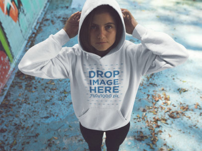 Young Girl Wearing a Pullover Hoodie While Standing in an Abandoned Pool Mockup a12854
