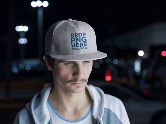 Video Mockup of a Young White Man Wearing a Snapback Hat While in the City at Night a14166