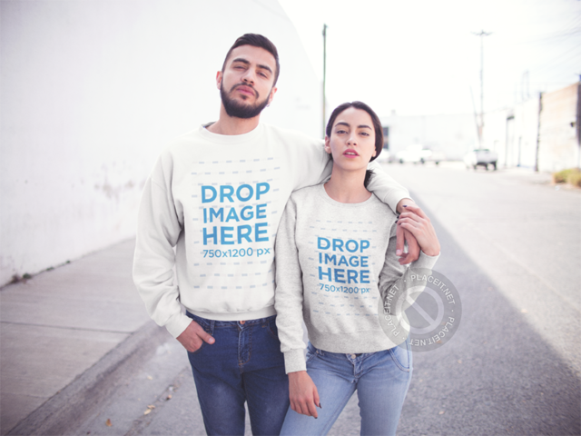 Beautiful Hispanic Couple Wearing Matching Crewneck Sweatshirts While Walking on the Street Mockup a13431