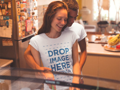 Young Couple Wearing Same Tees and Hugging While at the Kitchen Template a13486