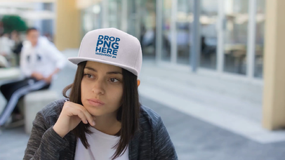 Serious Young Hispanic Girl Wearing a Snapback Hat While Hanging out at the Cafeteria Video Mockup a14207