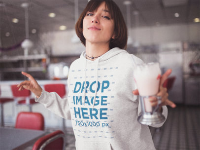 Template of a Young Girl Dancing While Holding a Milkshake Wearing a Pullover Hoodie a12674