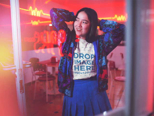 Young Asian Girl Wearing a Round Neck Tee With Blue Clothes While Posing Inside a Diner Restaurant Template a13588