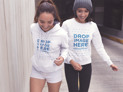 Couple of Girls Wearing a Pullover Hoodie and a Crewneck Sweatshirt While Walking out of a Tunnel Template a13352
