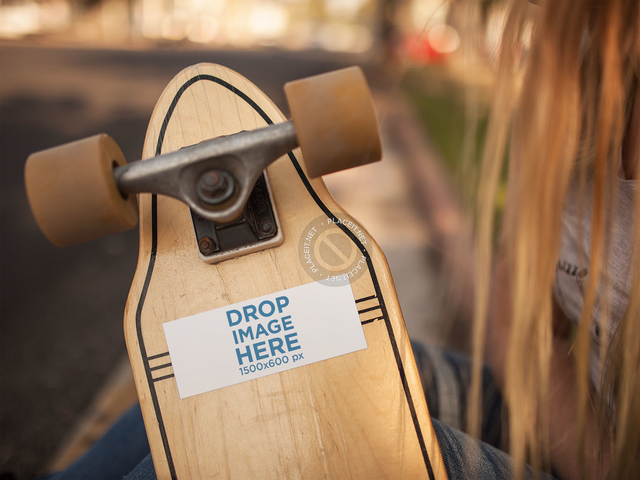 Long Haired Girl Holding a Longboard With a Sticker Glued to it While Outdoors Mockup a14309