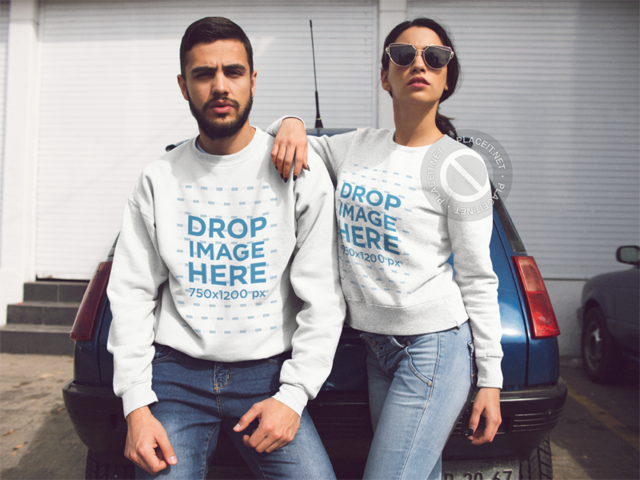 Hispanic Couple Wearing Crewneck Sweatshirts With Same Designs While Lying on an Old Car Mocukp a13425