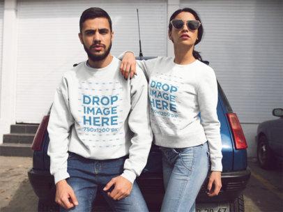 Hispanic Couple Wearing Crewneck Sweatshirts With Same Designs While Lying on an Old Car Mocukp a13425