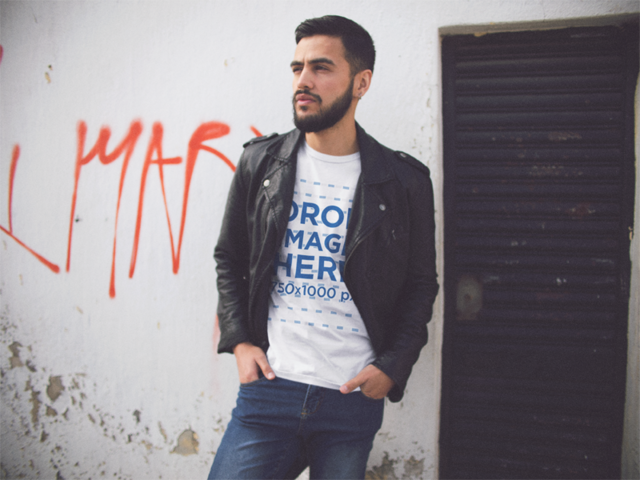 Young Hipster Hispanic Man Wearing a Round Neck Tee and a Leather Jacket While Hanging Out Mockup a13422