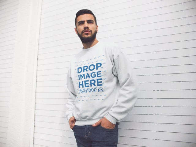 Young Hispanic Man Wearing a Crewneck Sweatshirt While Standing Near a White Facade Template a13427
