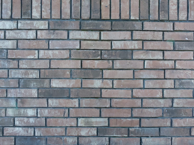 Video of a Vertical Poster Mockup on a Bricks Wall a13775