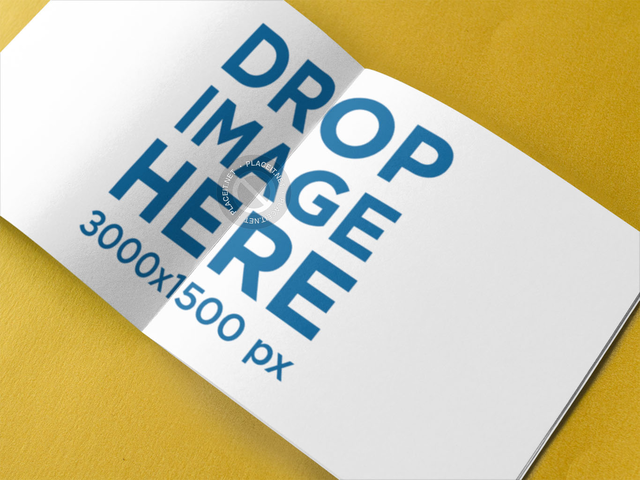 Open Booklet on a Yellow Surface Mockup a14578