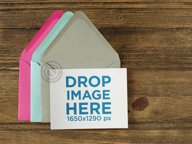 Invitation Template Over Three Colorful Envelopes on a Wooden Template a14712