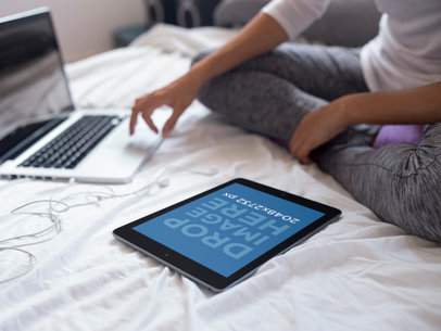 Upside Down Black iPad Template Lying on a Bed Near a Girl Using a MacBook 14262a