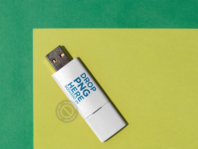 Mockup of a USB Flash Drive Lying Diagonally Over a Green and Yellow Surface a14911