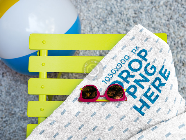 Sunglasses on a Towel Mockup Lying Near a Beach Ball a14898
