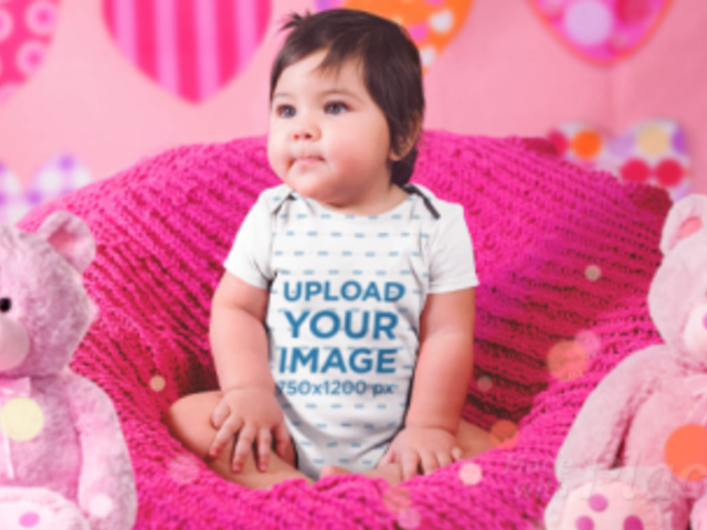 Parallax Video of a Little Baby Girl Sitting On A Pink Sofa While Wearing A Onesie 2526