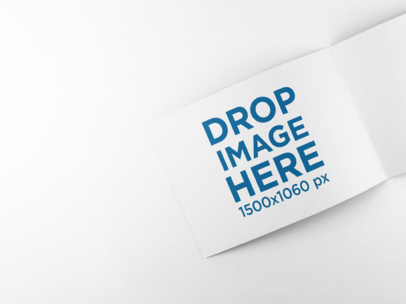 Open Rectangular Booklet Mockup Lying on a Solid Surface a15101