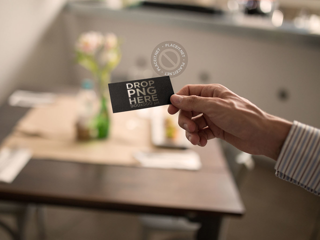 Guy Holding a Foil Business Card Template While Inside a Restaurant a15009