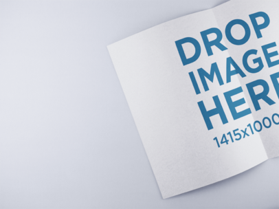 Open Booklet Mockup Lying on a Solid Color Surface a15082