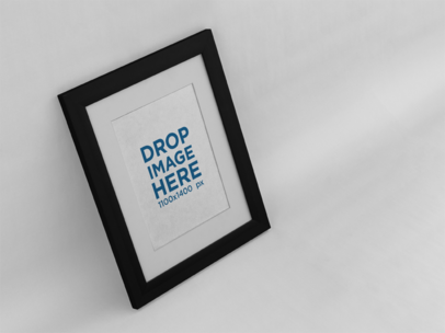 Angled Framed Art Print Mockup on a Solid Color Wall a15280