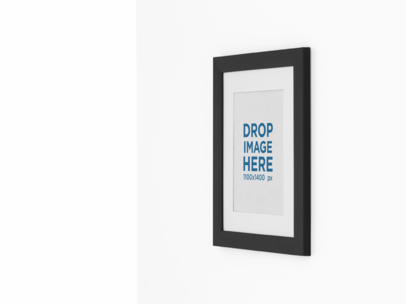 Mockup of a Framed Art Print on a Wall From a Side a15278