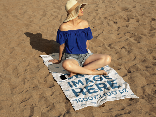 Young Lady Sitting on a Towel Mockup While at the Beach a14891
