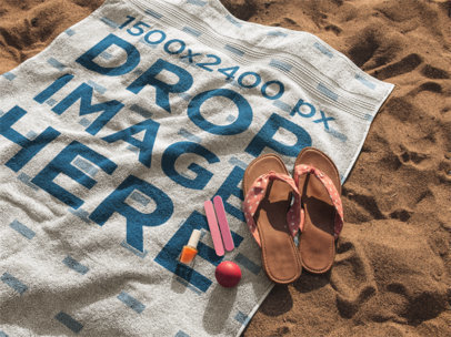 Beach Towel Mockup Lying on the Sand with Sandals and Accessories on it a14890