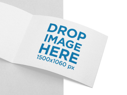 Open Booklet Mockup Lying on a Bicolor Surface a15125