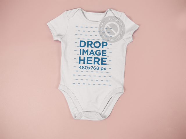 Baby Onesie Mockup Lying on a Pink Surface a15264