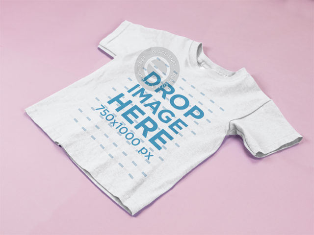 Kids T-Shirt Mockup Lying on a Pink Surface a15260
