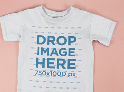 Closeup Template of a Kids Tshirt Lying on a Pink Surface a15261