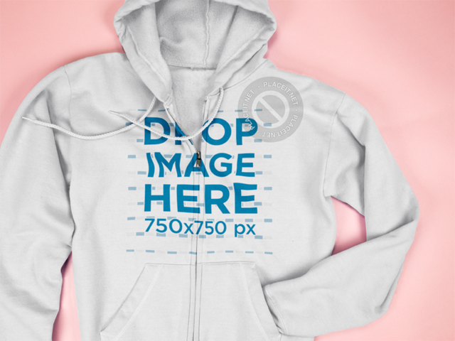 Mockup of a Full Zip Hoodie Hiding a Sleeve Lying on a Pink Surface a15241