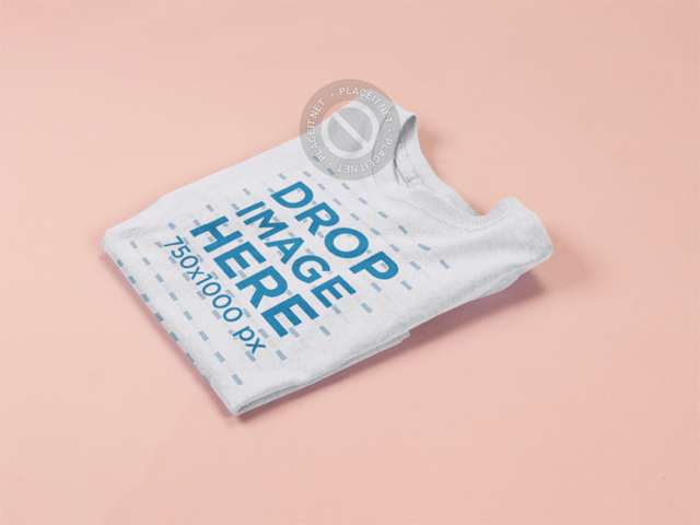Mockup of a Folded Kids Tshirt on a Solid Surface a15262