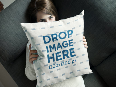 Young Girl Hiding Behind a Square Pillow Mockup a14936