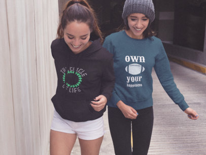 Pair of Girlfriends Walking Outside of a Tunnel While Wearing a Pullover Hoodie and a Crewneck Sweatshirt with Different Designs Mockup a15479