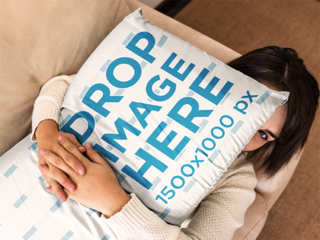 Young Girl Holding a Big Pillow Mockup While Lying Down a14938