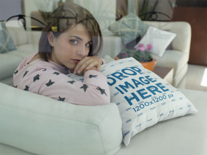 Young Girl Looking at the Camera While Lying Against a Square Pillow Mockup a14935