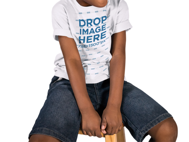Black Child Wearing a Round Neck Tee Mockup Sitting on a Wooden Stool While Against a Transparent Backdrop a15519