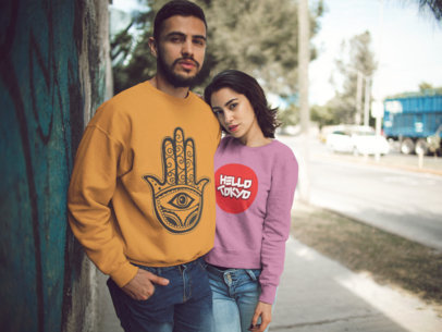 Mockup of a Couple Wearing Different Crewneck Sweatshirts Designs While Hugging Outdoors a15570