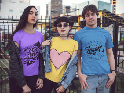 Three Young Friends Wearing Tshirts Template with Different Designs in the City a15552