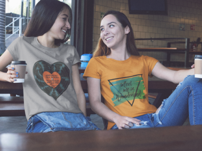 Two Girls Having a Coffee Wearing Different Tees Mockup a15578
