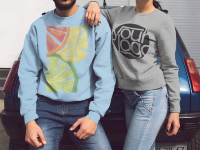 Mockup of a Couple with Cropped Face Lying on a Blue Car While Wearing Different Crewneck Sweatshirts a15643