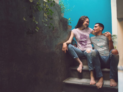 Mockup of a Young Couple Sitting on a Concrete Stairway Wearing Different T-Shirts a15551