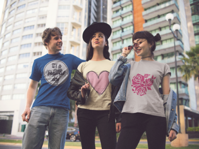 Three Young Friends Wearing Different T-Shirts Mockup While in the City a15692
