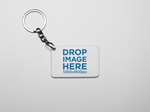 Small Keychain Mockup Lying on a Solid Color Surface a15406