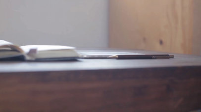 Top Shot App Demo Video of a White iPhone Lying on Landscape Position on a Wooden Desk a15605