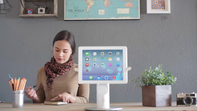 App Demo Video Featuring an iPad in Landscape Position Near a Girl in the Office a15617