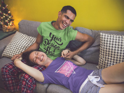 Couple Making Jokes Wearing Different Round Neck Tees Mockup Holding Hands in the Sofa a15737